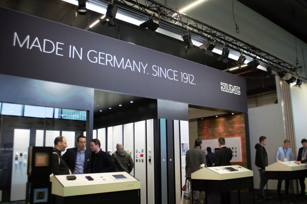 Jung Stand at ISE 2020. Wall Mount Producer from Germany. Wall Mounts and People Talking.