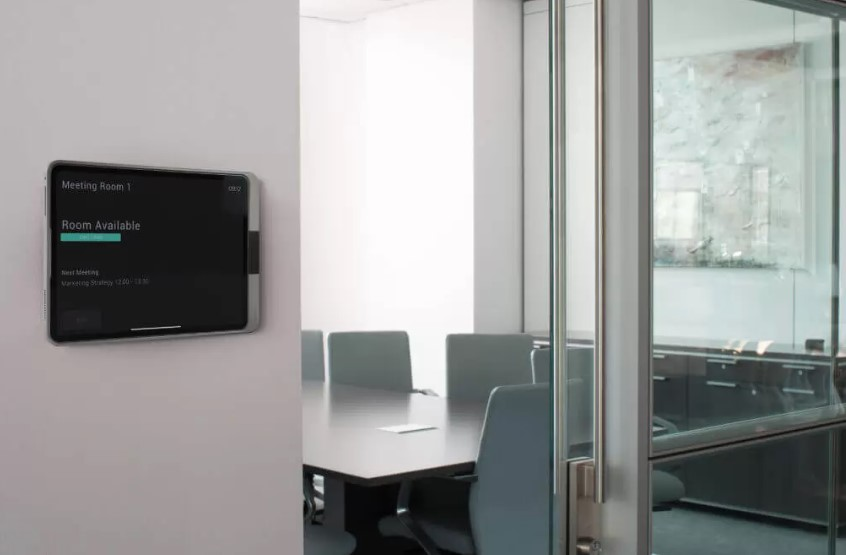 one wall mount for iPad Air 3 on a wall in front of a conference room